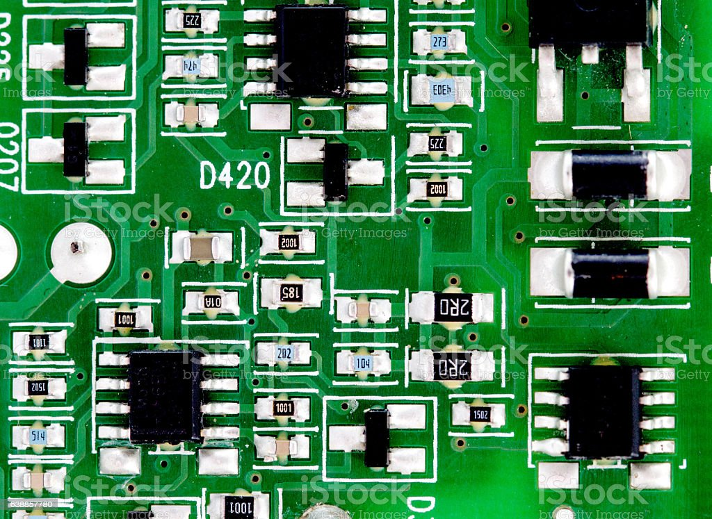 electronic printed circuit board with many electrical components stock photo