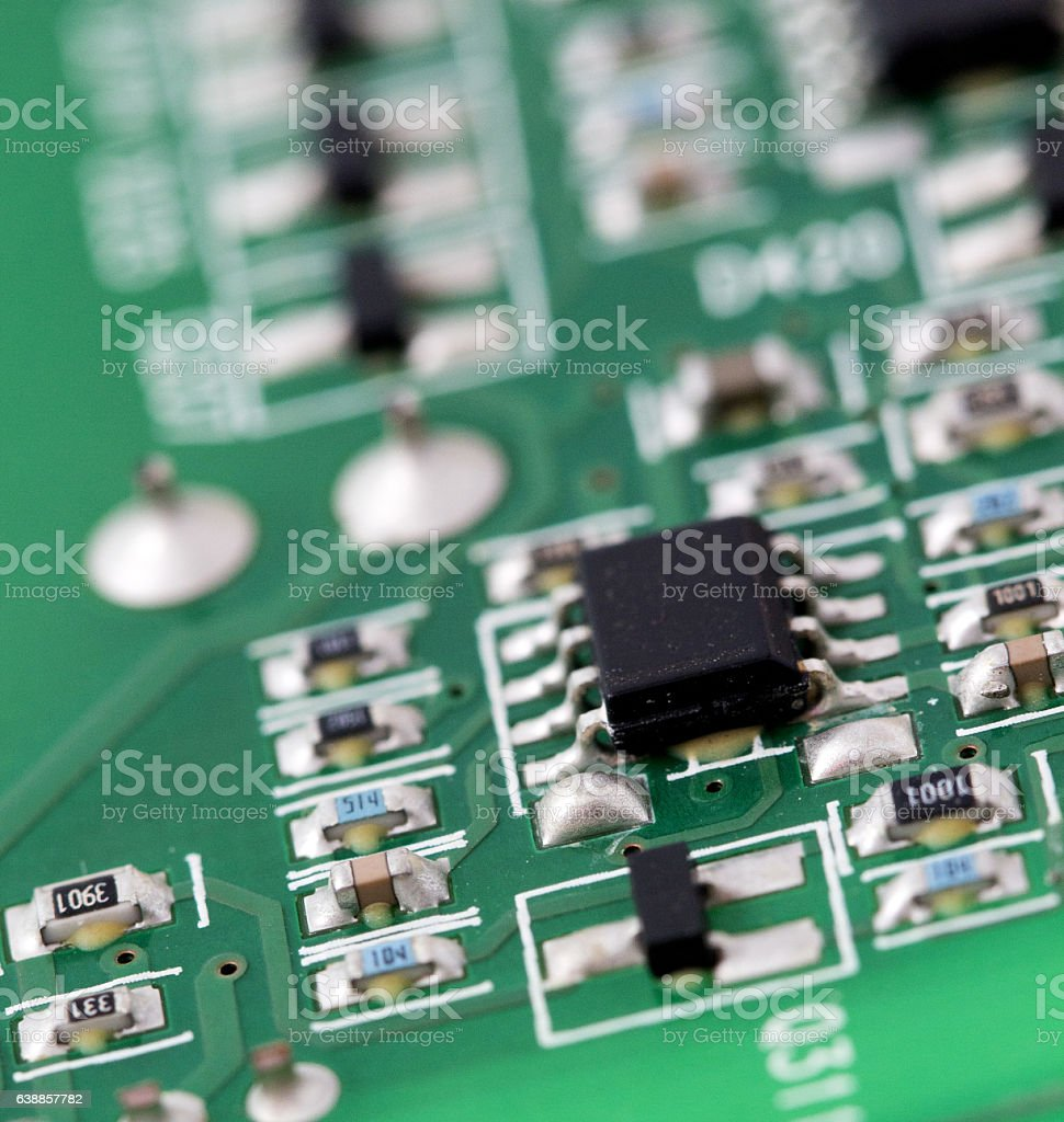 electronic printed circuit board with many electrical components rh istockphoto com