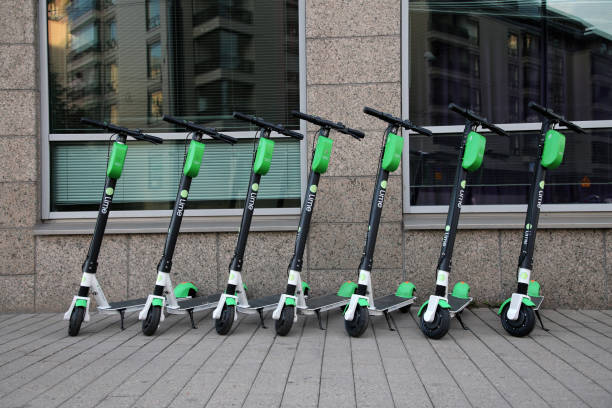 Electronic Rental Scooters from Lime in Downtown Helsinki, Finland stock photo