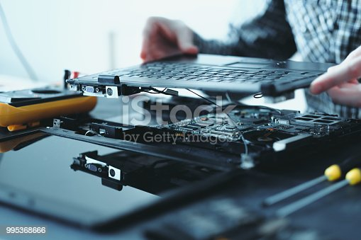 istock electronic repair engineer broken laptop keyboard 995368666