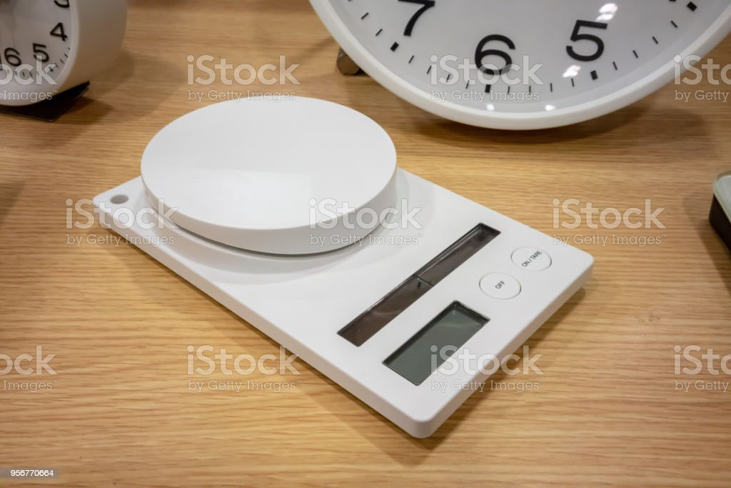 Electronic Scales for multi-purpose weighing on wooden table stock photo