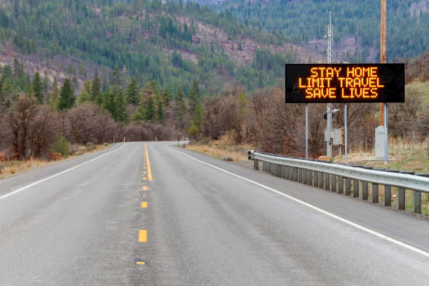 Electronic sign along U.S. Highway 97 notifying people to stay home and save lives by reducing the risk of being infected due to COVID-19 Electronic sign along U.S. Highway 97 notifying people to stay home and save lives by reducing the risk of being infected due to COVID-19 avoidance stock pictures, royalty-free photos & images