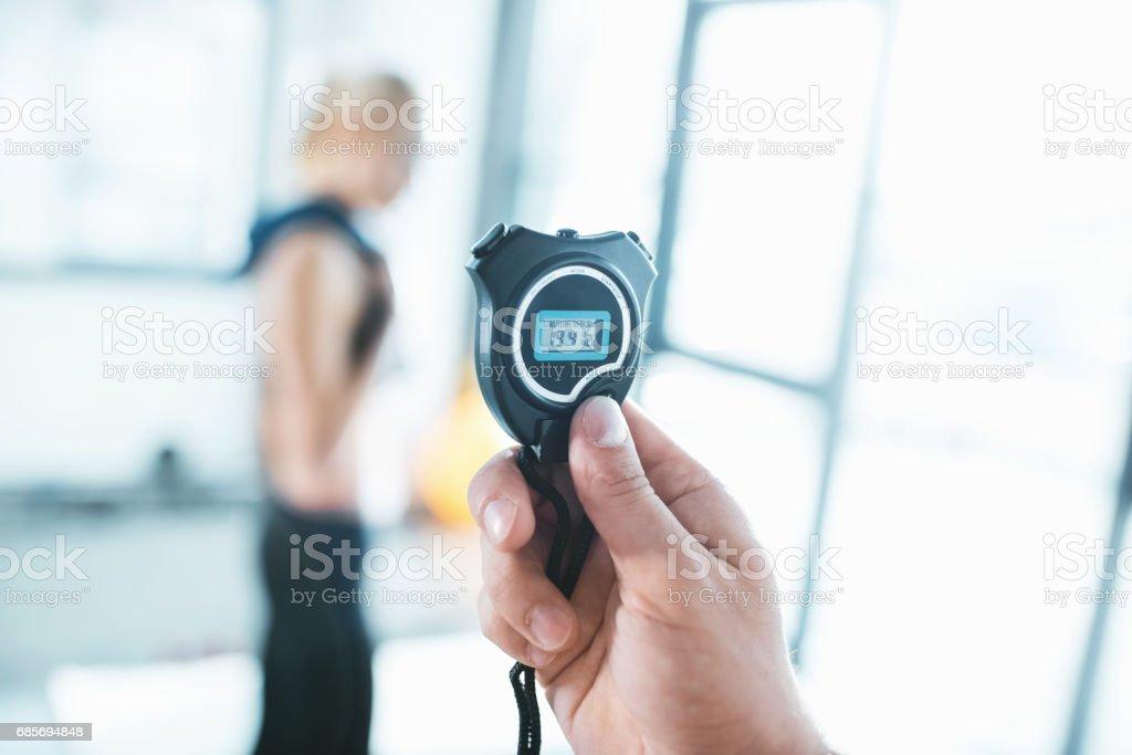 Electronic sport timer in hand, selective focus Lizenzfreies stock-foto