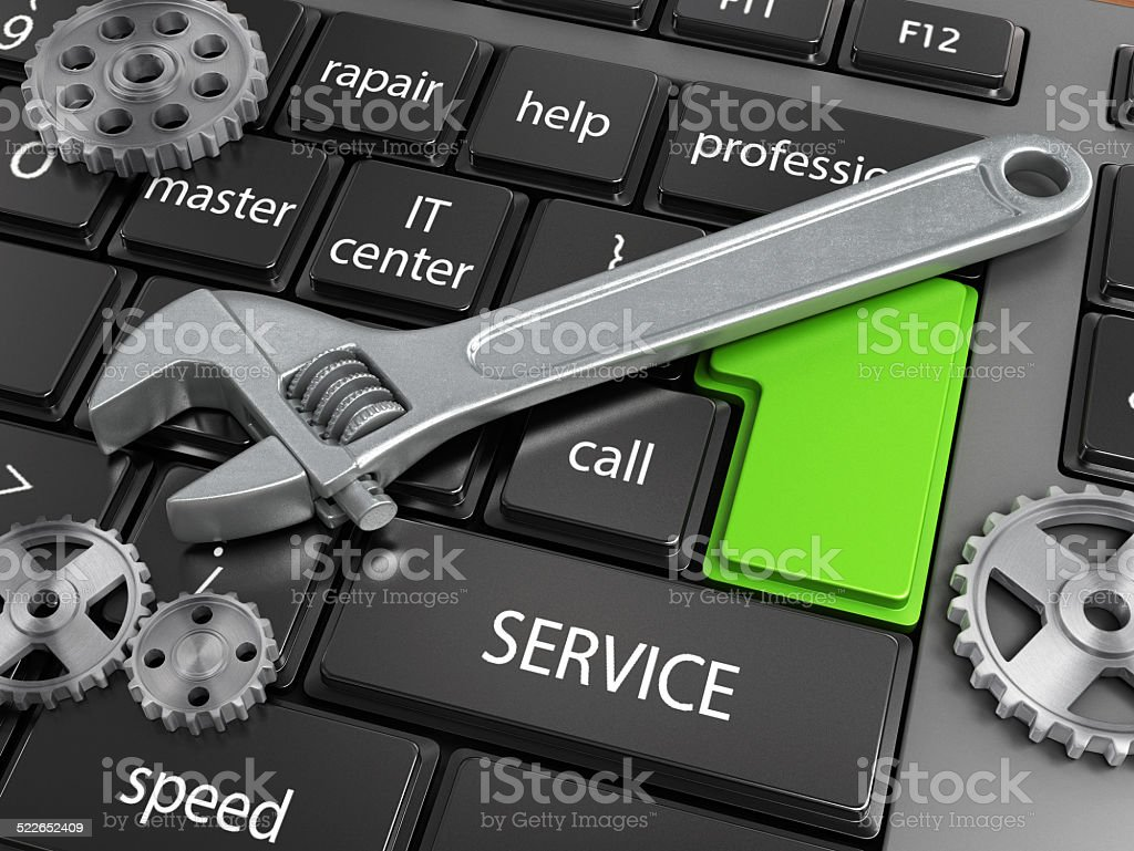 electronic technical support concept - spanners on computer keyboard stock photo