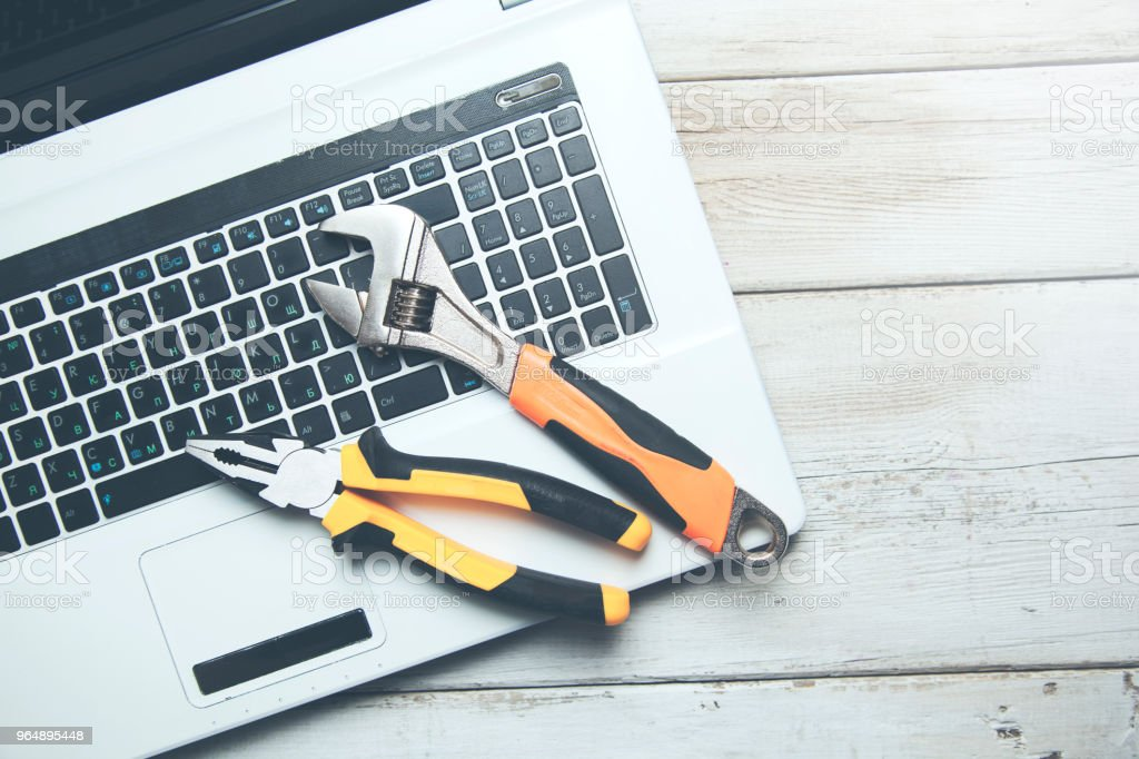 Electronic technical support concept. Spanners on computer keyboard. royalty-free stock photo