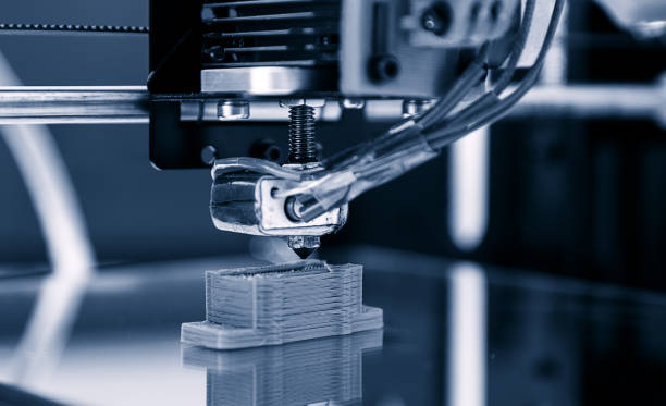 Electronic three dimensional plastic printer during work , 3D , printing. stock photo
