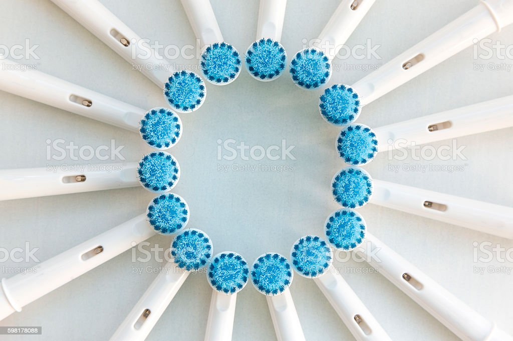 Electronic toothbrush heads on white stock photo