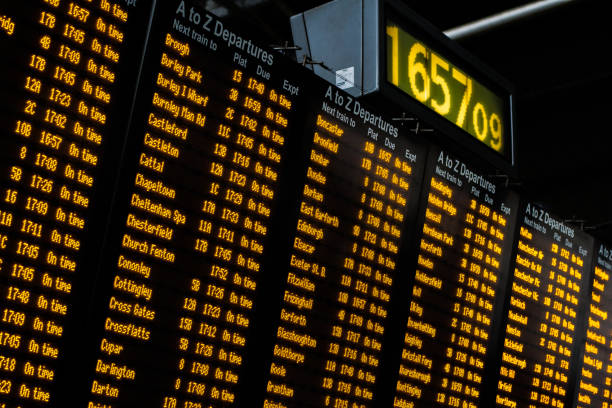 electronic train station information board - arrival departure board stock photos and pictures