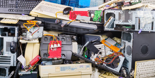 Electronic waste heap from used discarded computer parts and cases. Refuse sorting and disposal stock photo
