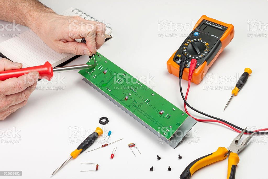 Electronics Engineer Soldering Component To A Circuit Board Stock ...
