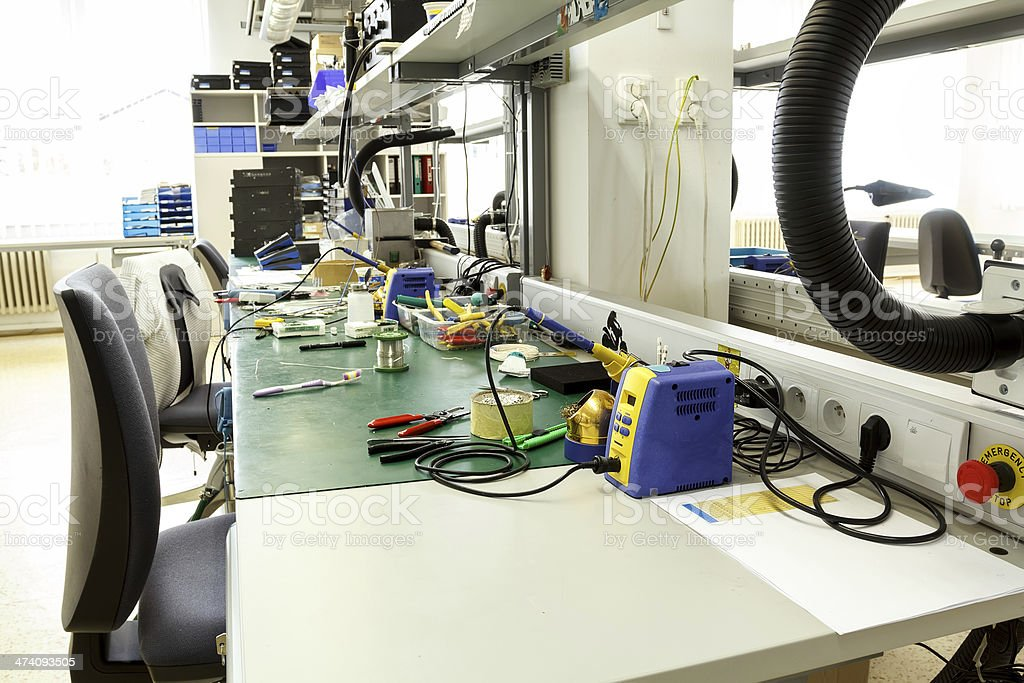 electronics equipment assembly workplace stock photo