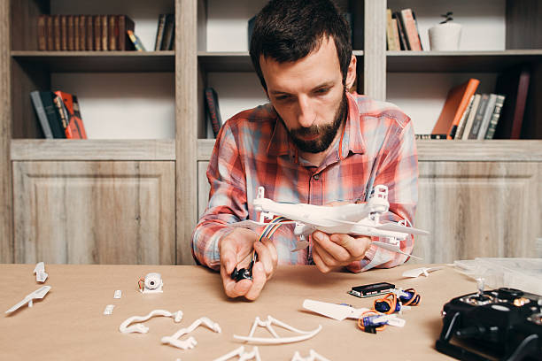 Electronics of disassembled drone repairing stock photo