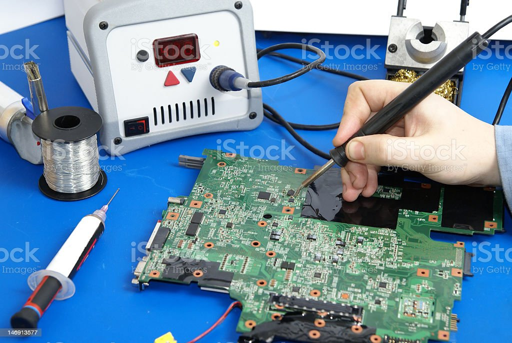 electronics repair - soldering royalty-free stock photo