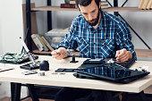 istock Electronics repairman workplace 619252080