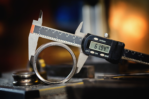 istock Electronis calipers on an old bearing detail. 1054942592