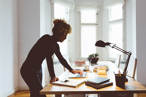 Elegance Afro American Young Woman In A Home Office Stock Photo - Download Image Now
