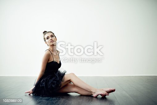 Full length shot of an attractive young female interpretive dancer practicing in her dance studio