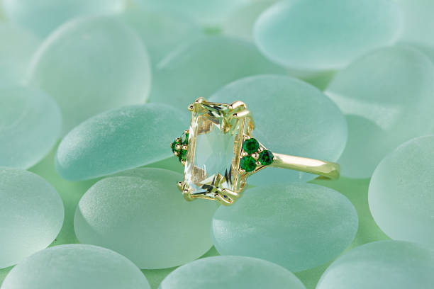 Elegance gold ring with green gemstone stock photo