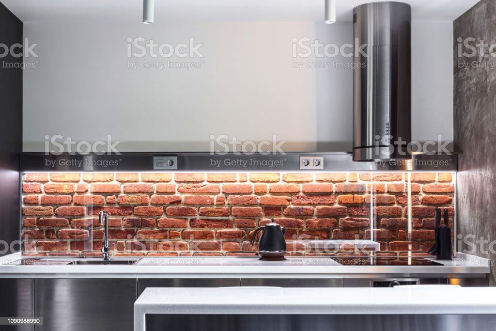 Elegance interior concept. Photo of modern kitchen with red brick...