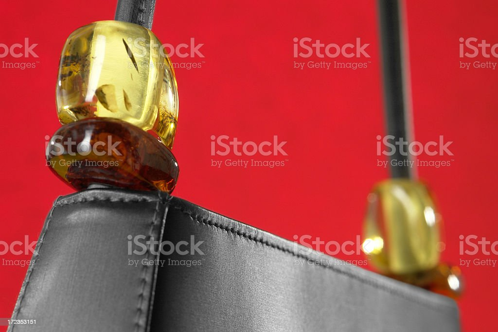 Elegance & Luxury handbag with big amber pieces royalty-free stock photo