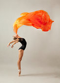 Professional Ballet Dancer performing elegant move. High Speed strobes were used with 5DmkII camera, to ensure highest photo quality and resolution
