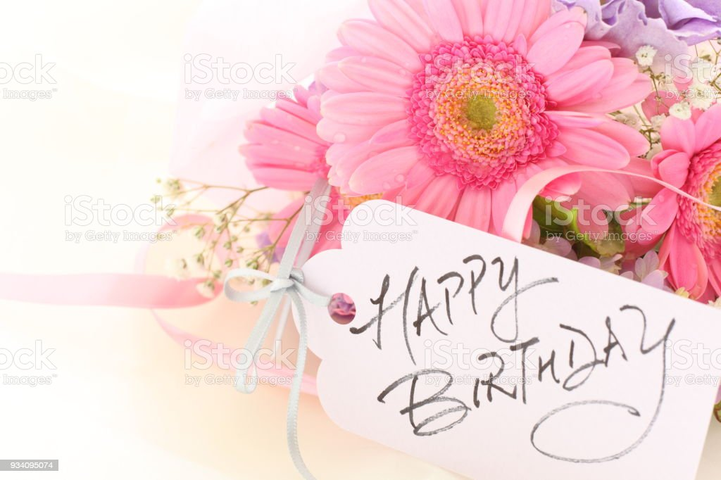 elegance pink gerbera and hand written Birthday card stock photo