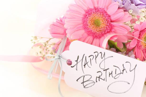 elegance pink gerbera and hand written Birthday card - foto stock