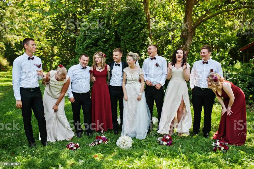 Elegance wedding couple with bridesmaids and best mans having fun. Crowd of friends on wedding. Ten people. stock photo