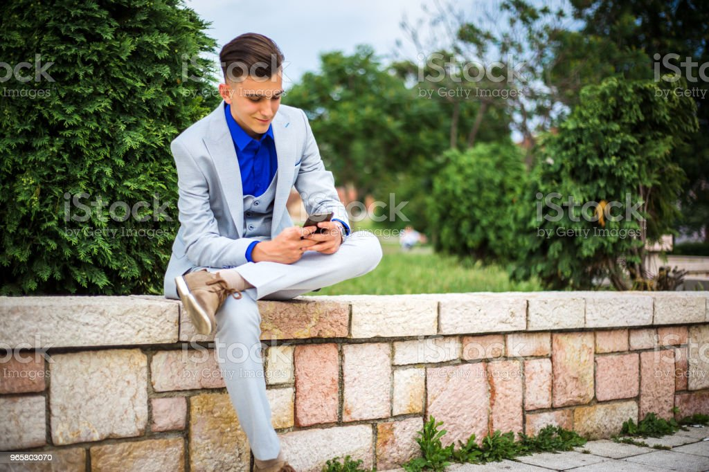 elegance young man using mobile phone - Royalty-free 18-19 Years Stock Photo