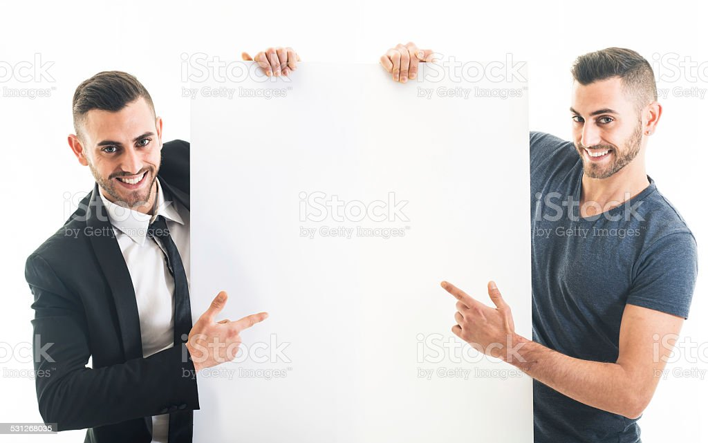 Elegant and Casual Bearded Man Holding a Blank Sign stock photo