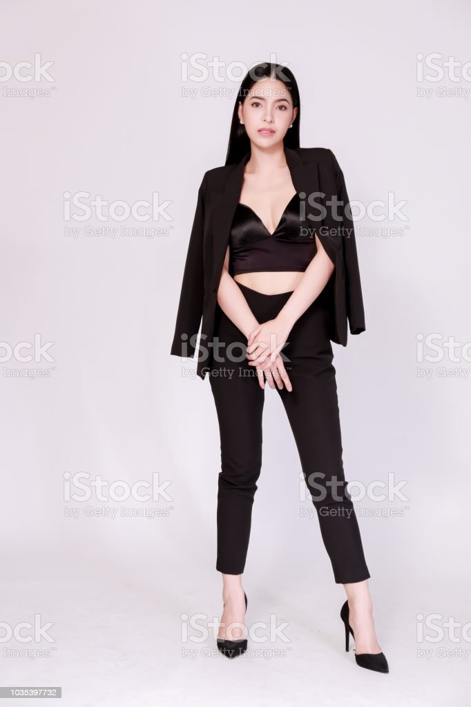 494bb53c47e Elegant and modern Asian confident business woman in lookbook style isolated  over white background. royalty