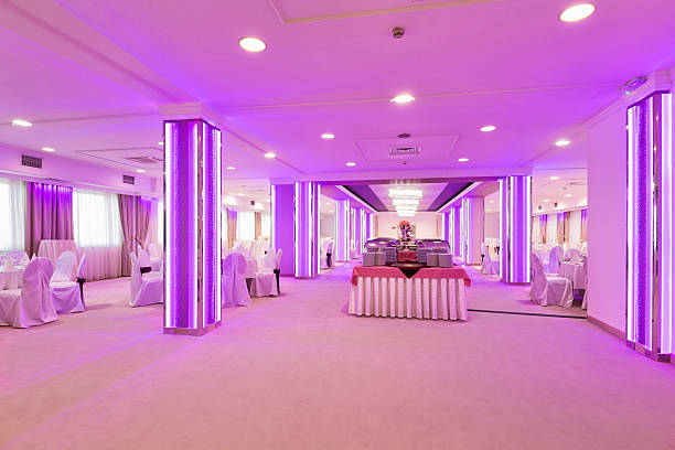 Elegant banquet hall with pink lights stock photo