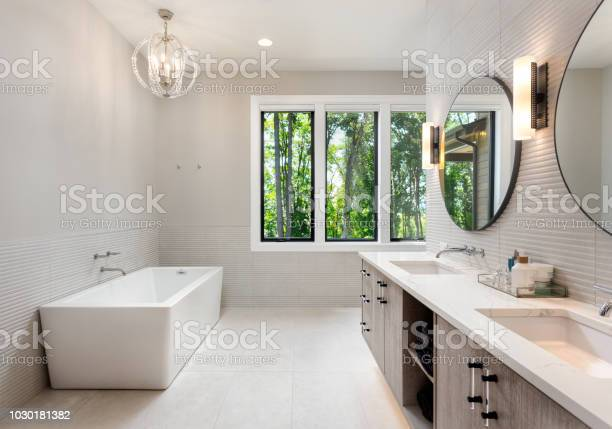 Elegant bathroom in new luxury home with two sinks bathtub and picture id1030181382?b=1&k=6&m=1030181382&s=612x612&h=brzq4vmvu78duzdss8axsr4lktbwpwe5gcfogg7mvpi=