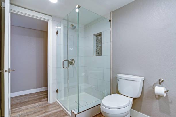 Elegant bathroom with hardwood floor. stock photo