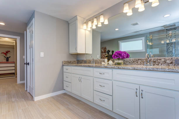 Elegant bathroom with long white vanity cabinet stock photo