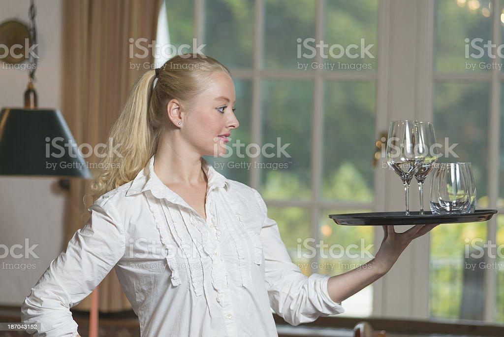 Elegant beautiful woman serving drinks royalty-free stock photo