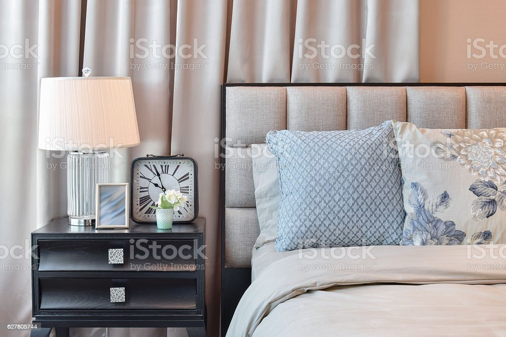 elegant bedroom interior design with floral pattern pillows on bed stock photo