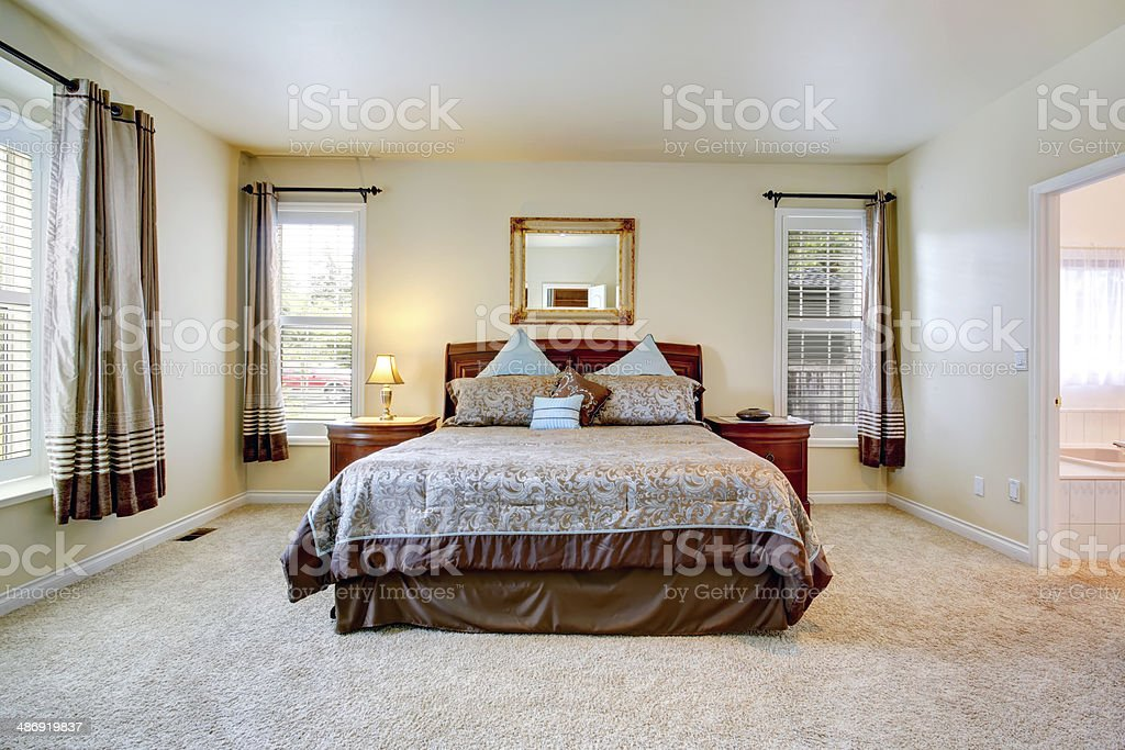 Elegant bedroom with beautiful bedding stock photo