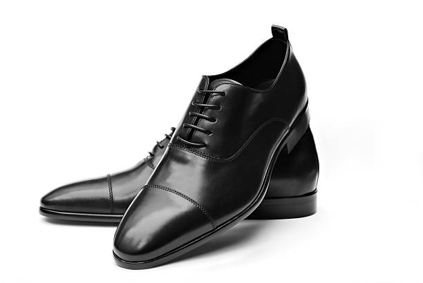 elegant black leather shoes - shoe stockfoto's en -beelden
