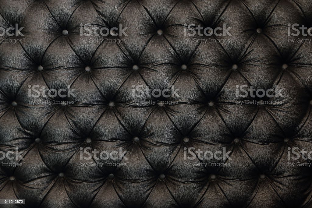 elegant black leather texture with buttons for pattern and background stock photo