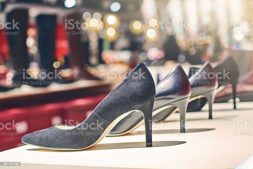 Elegant black woman shoes in a luxury store stock photo