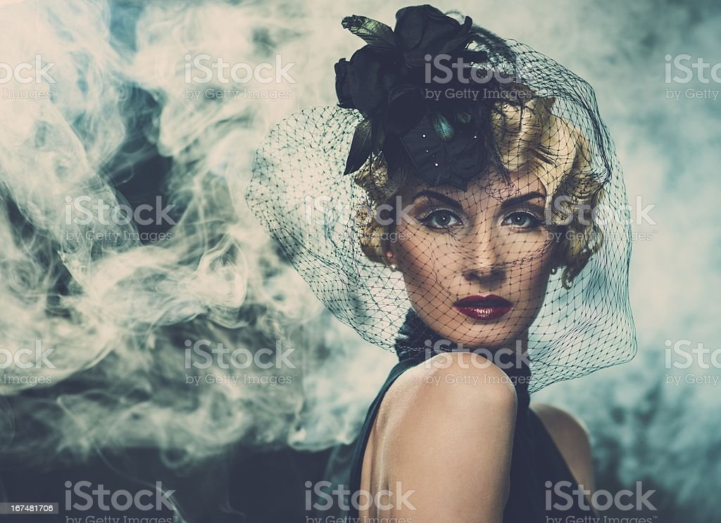 Elegant blond retro woman  wearing little hat with veil royalty-free stock photo