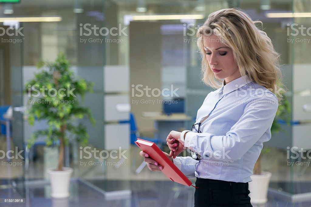Elegant blonde businesswoman in office interior stock photo