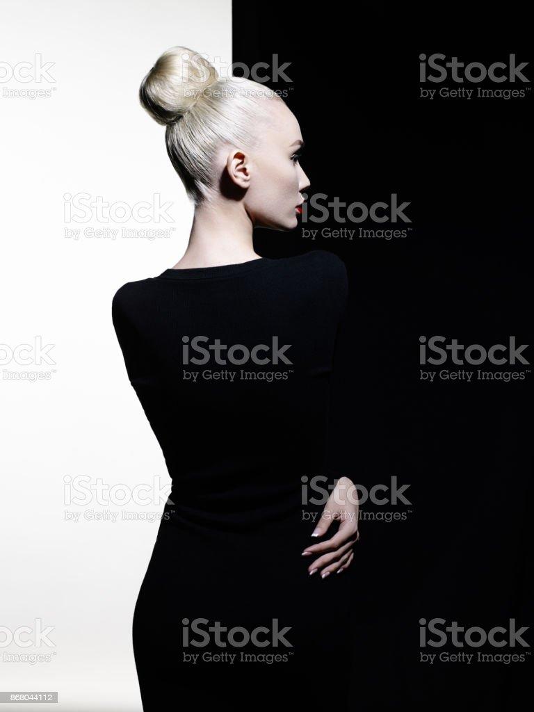 Elegant blonde in geometric black and white background stock photo