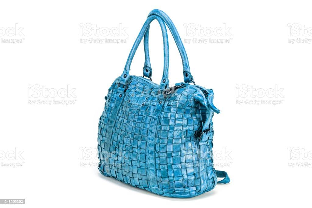 dc537de9dc Élégant sac à main bleu cousu d'entrelacées de lanières de cuir isolés sur  fond