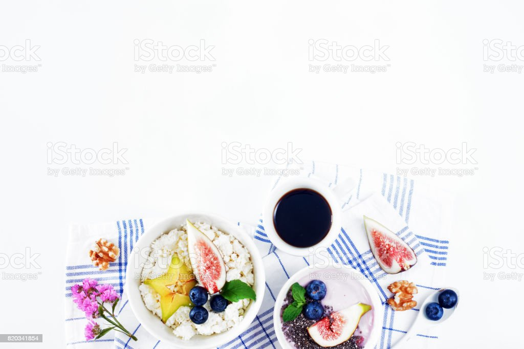Elegant breakfast on white table with copy space. stock photo