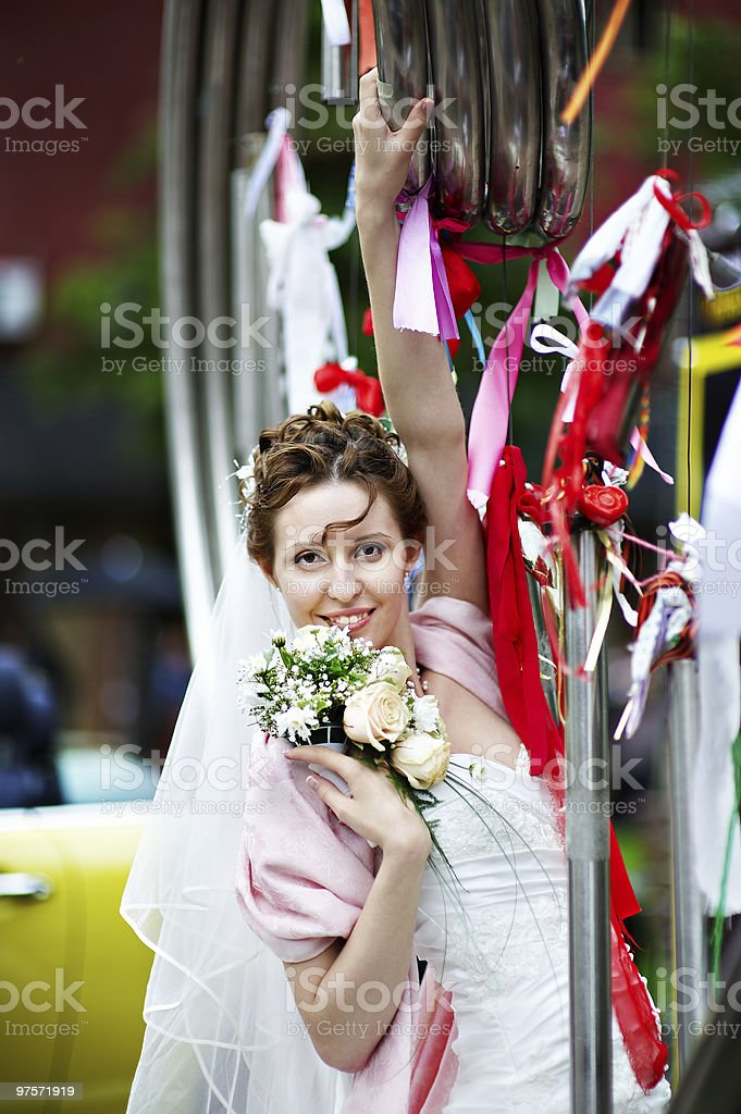 Elegant Bride at metal installation in the Park royalty-free stock photo