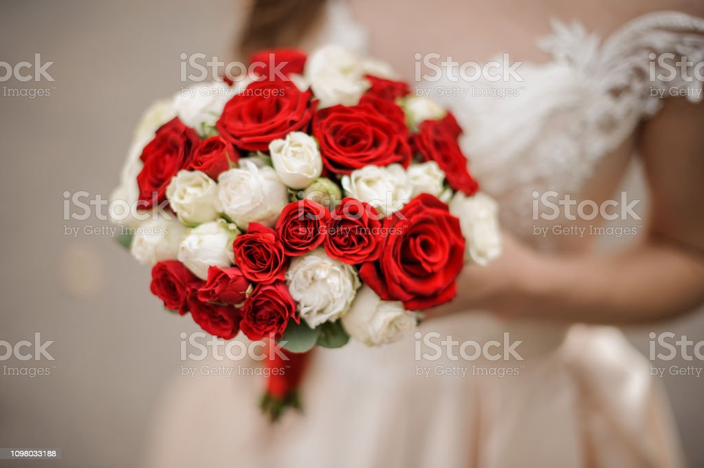 Elegant Bride In A Wedding Dress Holding A Bouquet Of White And