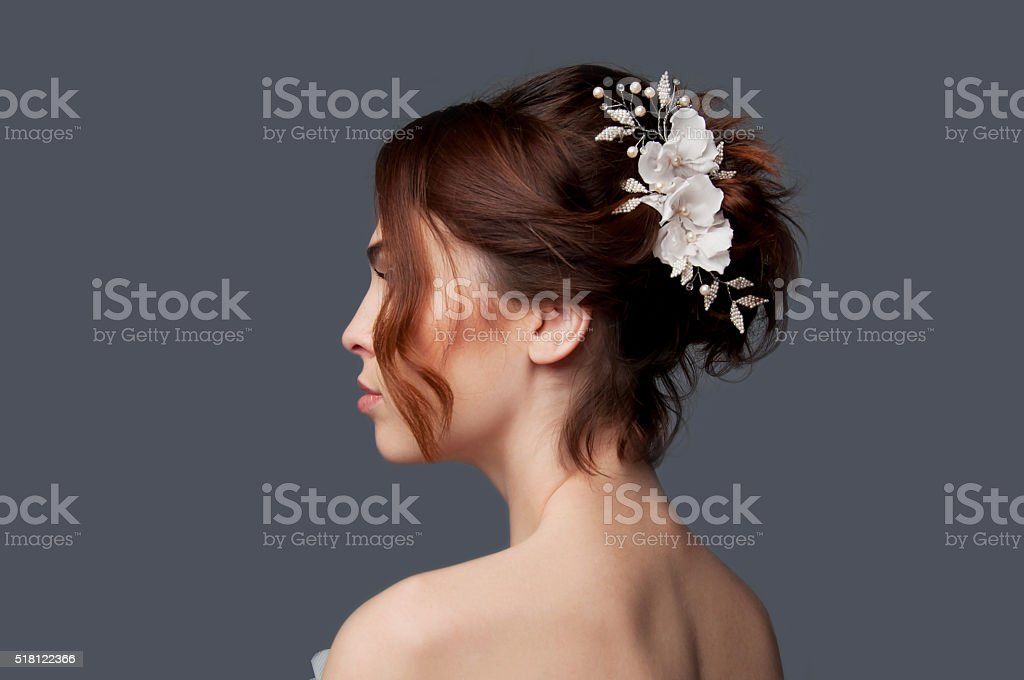 Elegant bride with short hair updo and bare shoulders dress stock photo