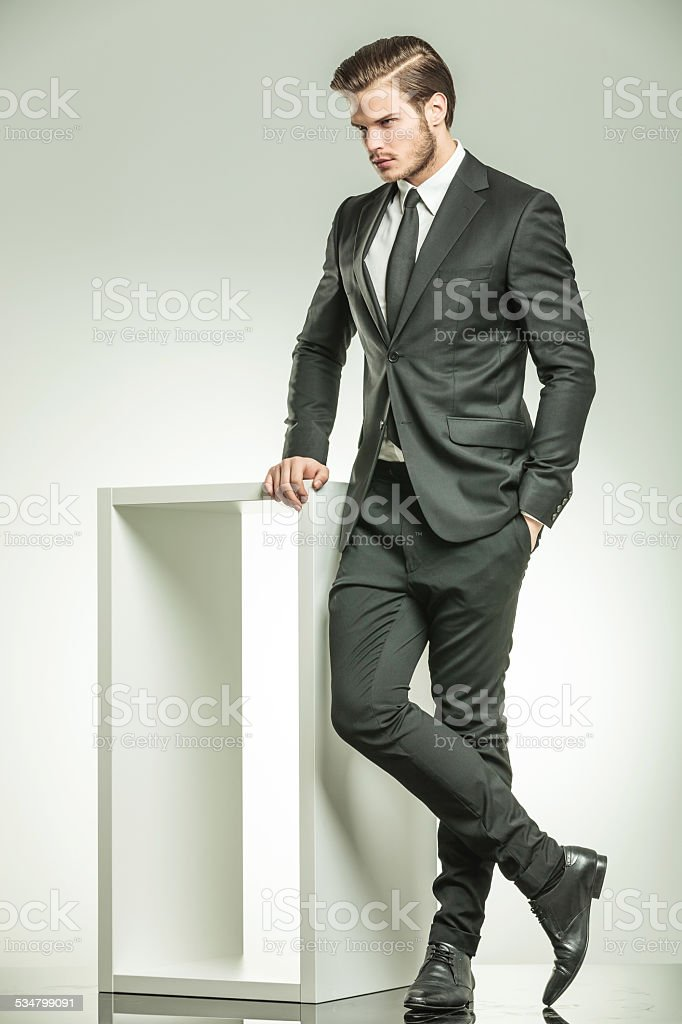 elegant business man looking down stock photo